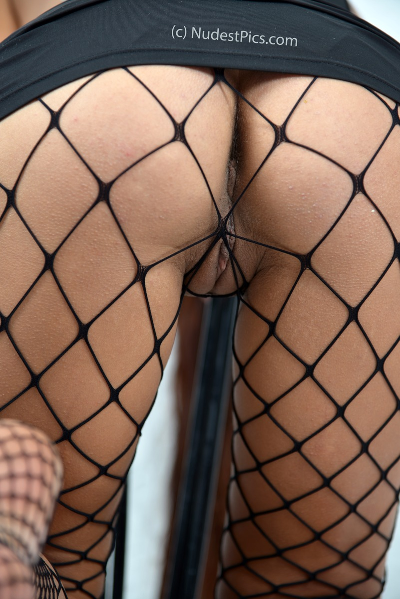 Girl Bends Her Ass Upskirt Fishnets