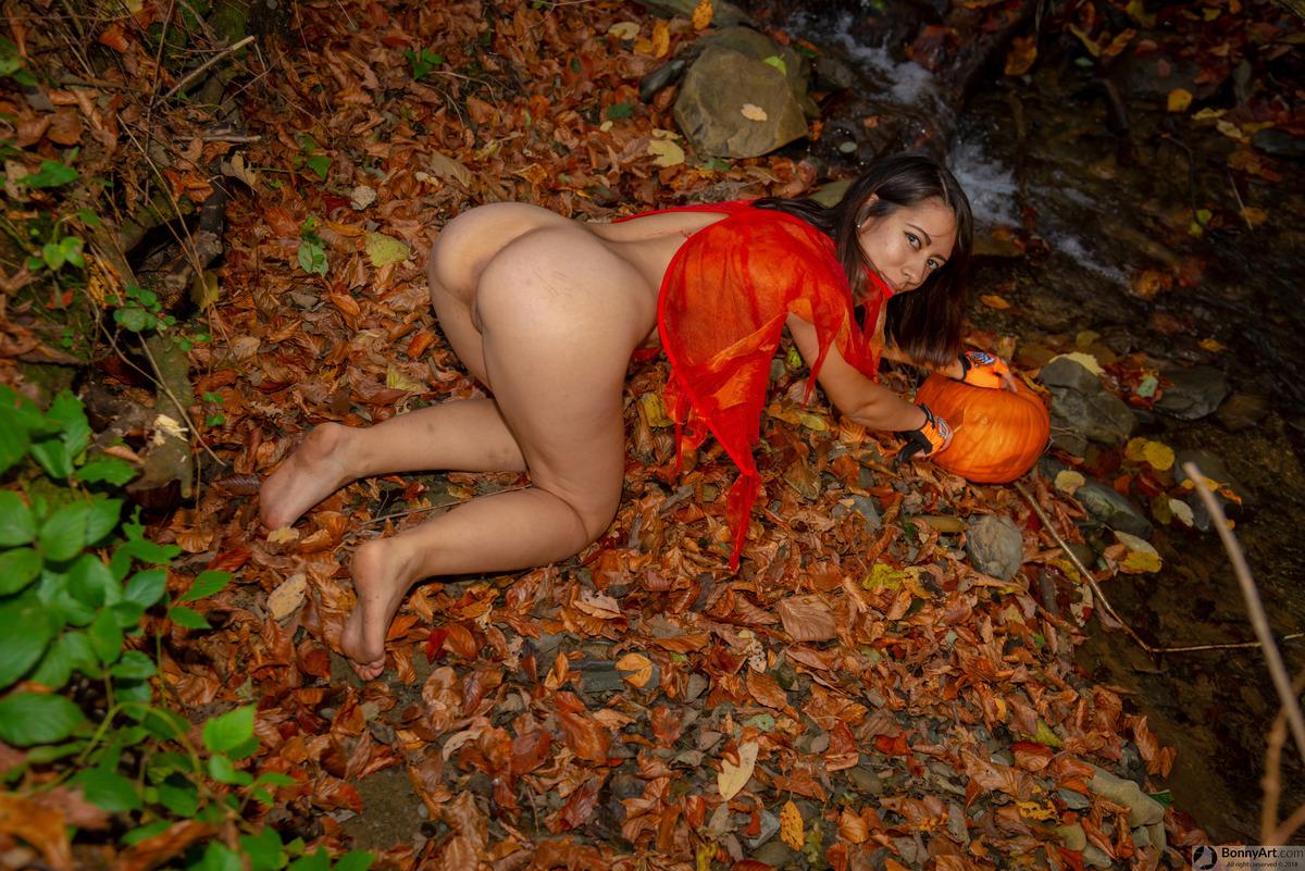 Halloween Girl Carving Pumpkin Nude Forest