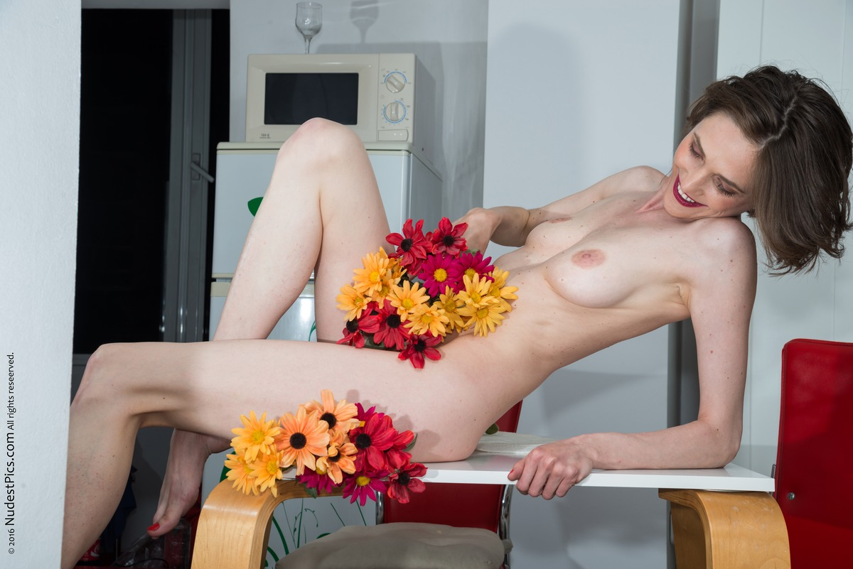 Beautiful Thin Woman Topless Joy of Flowers in the Kitchen
