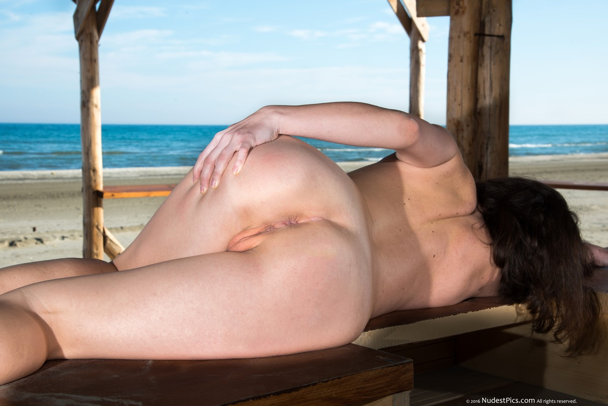 Nude Exhibitionist Girl Spreading Ass on Beach Bar