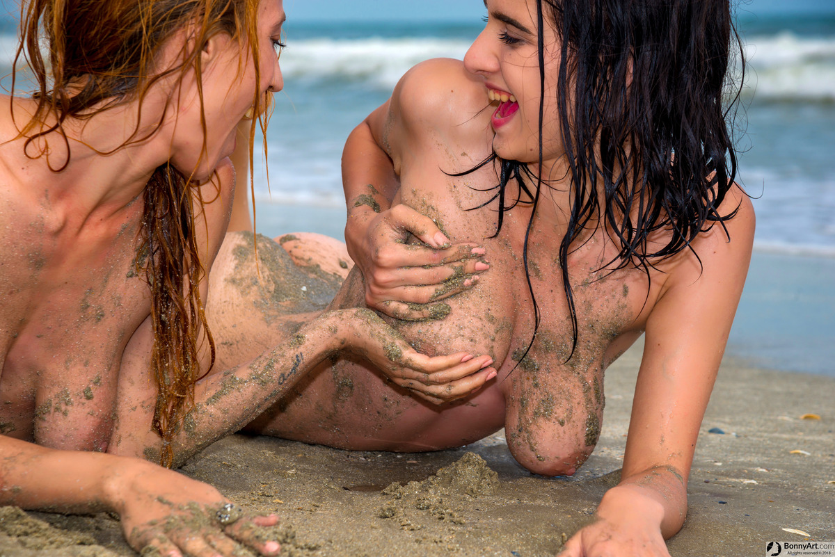 Nudist Women Fun with Tits and Sand