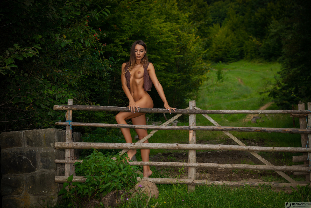 Beautiful Cowgirl naked at the Ranch