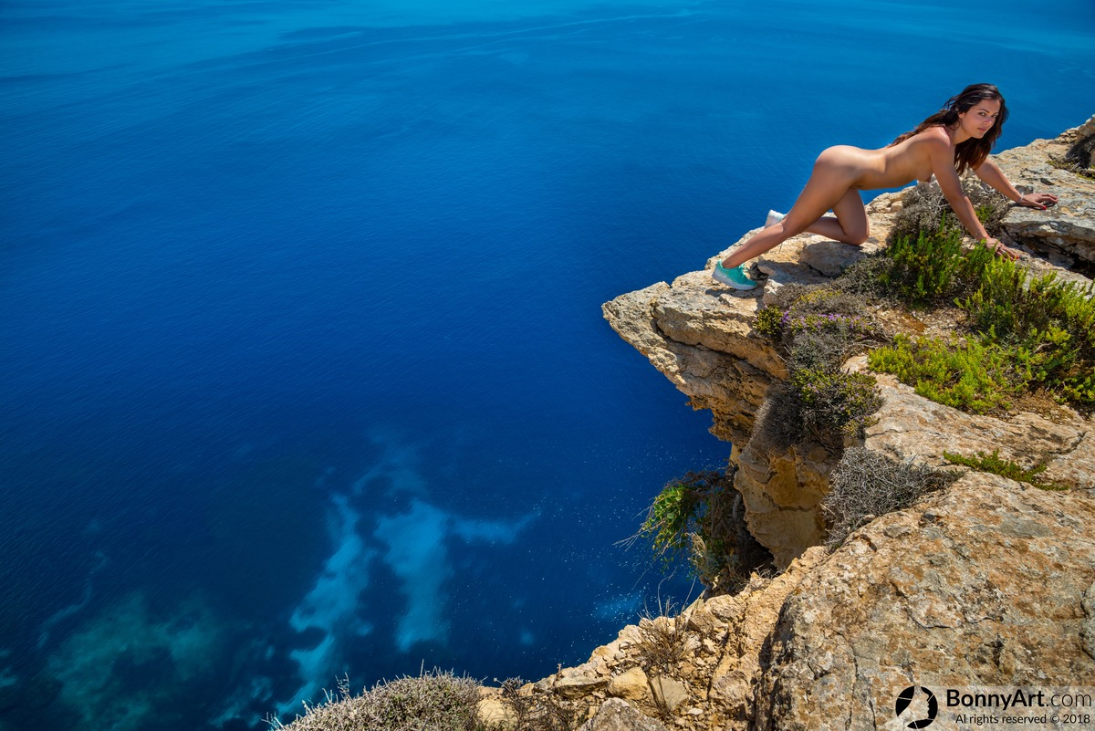 Naked Girl Workout on the Edge of the Abyss