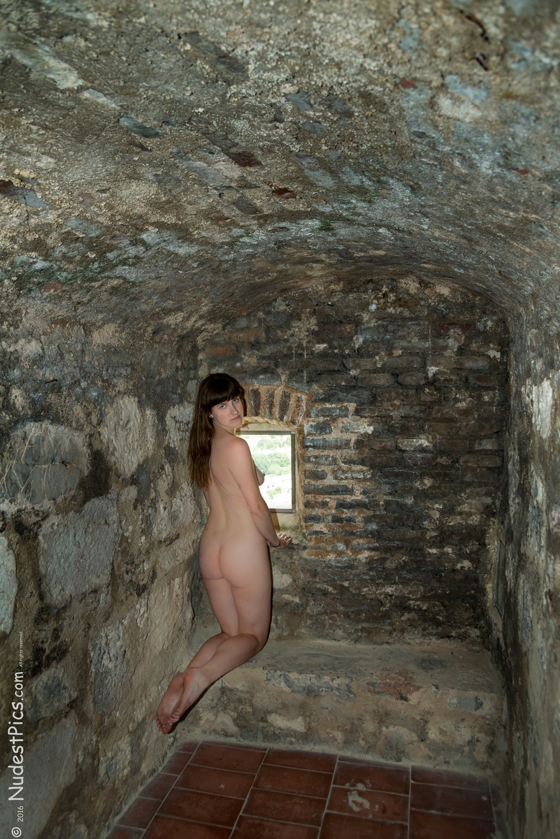 Naked Lady Kneeling in the Castle Cell